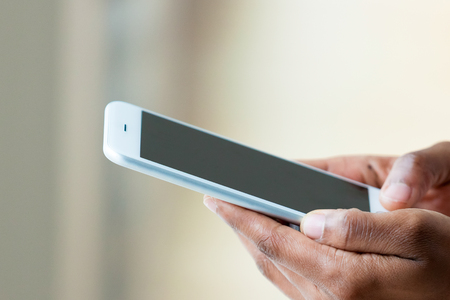 black hands: African american person holding a tactile mobile smartphone - Black people Stock Photo