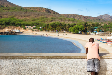 barlavento: African boy watching to Tarrafal beach in Santiago island in Cape Verde - Cabo Verde