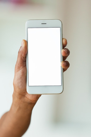 African american person holding a tactile mobile smartphone - Black people Standard-Bild