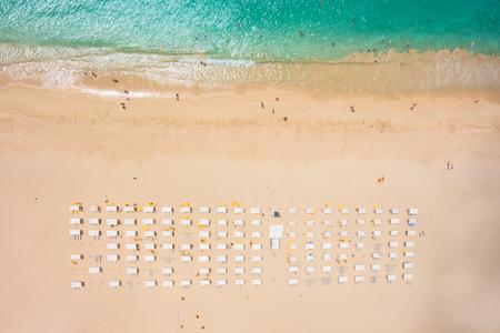 beach view: Aerial view of Santa Maria beach parasol and deck chair in Sal Island Cape Verde - Cabo Verde Stock Photo