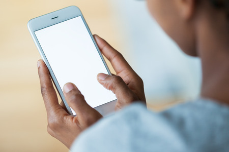 tactile: African american person holding a tactile mobile smartphone - Black people Stock Photo
