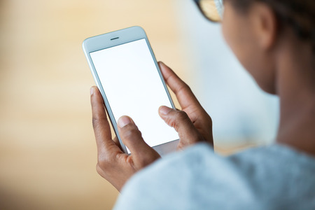 close up woman: African american person holding a tactile mobile smartphone - Black people Stock Photo