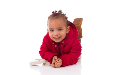 girl lying down: Portrait of little African American little girl lying down on the floor  - Black people Stock Photo