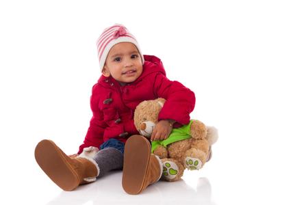 jacket: Retrato de la pequeña niña afroamericana que sostiene un oso de peluche