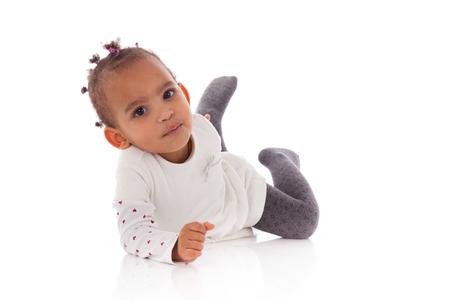 girl lying: Portrait of little African American little girl lying down on the floor  - Black people Stock Photo