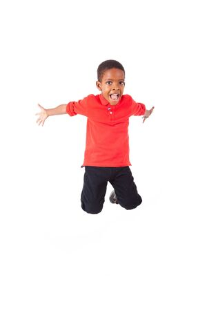 south american ethnicity: Portrait of a cute african american little boy jumping, isolated on white background