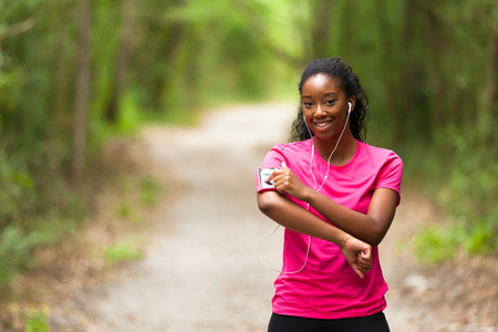 African american woman jogger portrait  - Fitness, people and healthy lifestyle photo