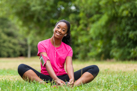 African american woman jogger stretching  - Fitness, people and healthy lifestyle photo