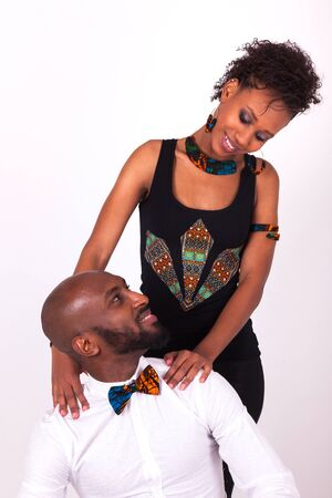 traditional clothes: Happy African American couple wearing traditional clothes over grey background