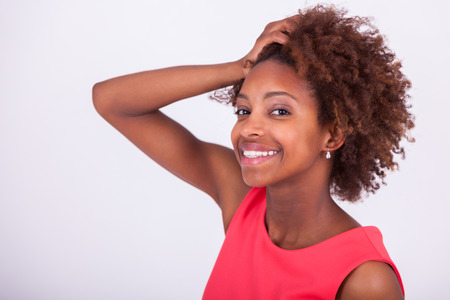 frizzy: Young African American woman holding her frizzy afro hair - Black people
