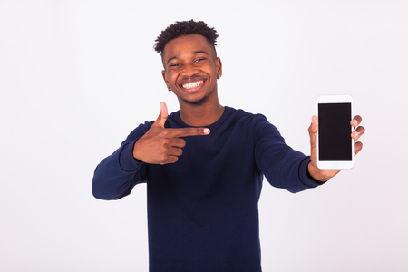 cellphones: Young African American man pointing his  smartphone screen - Black teenager people