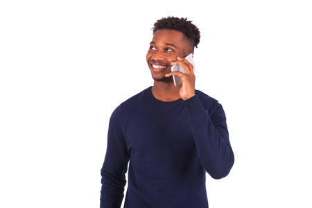 phone isolated: Young African American man making a phone call on her smartphone - Black teenager people Stock Photo