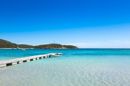 turquoise water: Pontoon  in the turquoise water of  Rondinara beach in Corsica Island in France