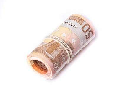 50 euro bank notes stack wrapped and rolled together Stock Photo
