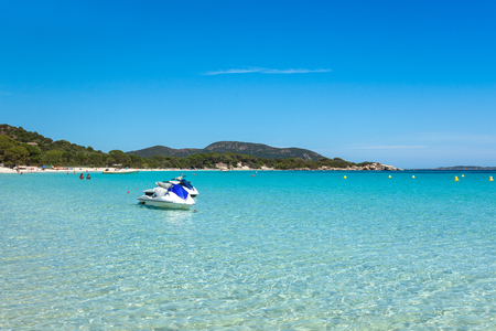 turquoise water: Jet ski mooring in the turquoise water of  Rondinara beach in Corsica Island in France
