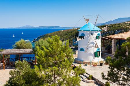 Old Windmill in Agios Nikolaos near blue caves in Zakynthos (Zante) island, in Greece