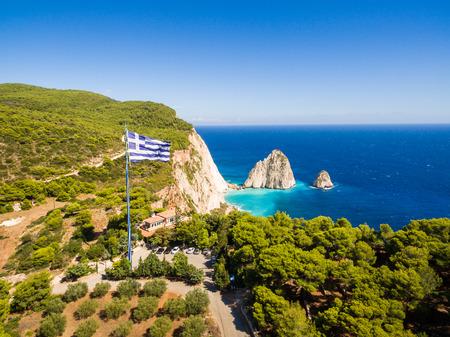 Greek biggest national flag waving in the sky in Keri in Zakynthos (Zante) island in Greece