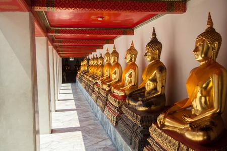 Buddha sitting in line and meditating Wat Pho  temple , Bangkok, Thailand