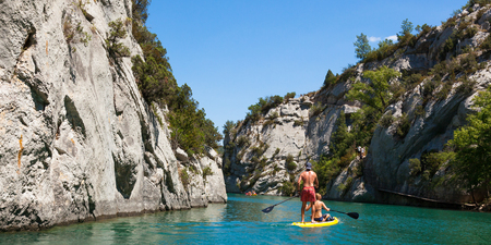 People doing standing paddle in  Gorge du Verdon canyon river in south of France