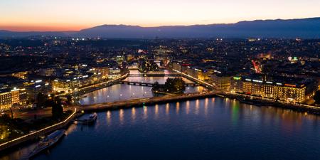 Aerial night view of Geneva city waterfront skyline in Switzerland Imagens