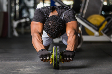 Black African American  young man doing  workout at the gym Imagens