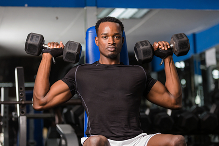 Black African American  young man doing  workout at the gym Stockfoto