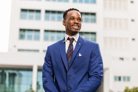 Outdoor standing portrait of a black African American business man