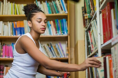 Black african american young girl student studying at the school university library