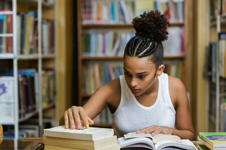 Black african american young girl student studying at the school university library Imagens - 124990070