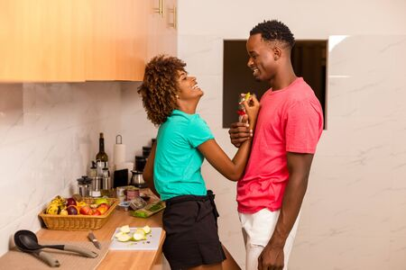 Black African American couple preparing food in the kitchen Stock Photo