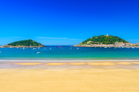 La Concha beach with nobody at San Sebastian Donostia, Spain. Best european beach in sunny day. travel destination.