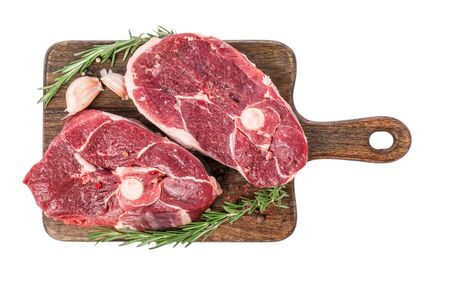 Raw lamb ham meat on a bone on wooden cutting board with herbs and spices isolated on white background. top view Stok Fotoğraf