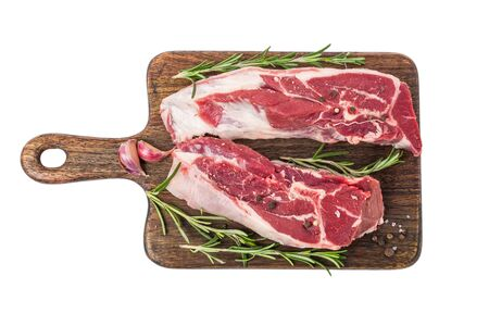 Raw lamb meat on a bone on wooden cutting board with herbs and spices isolated on white background. top view