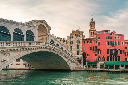 Rialto bridge on the Grand canal of Venice city with colorful architecture with nobody, Veneto, Italy during sunrise Stok Fotoğraf