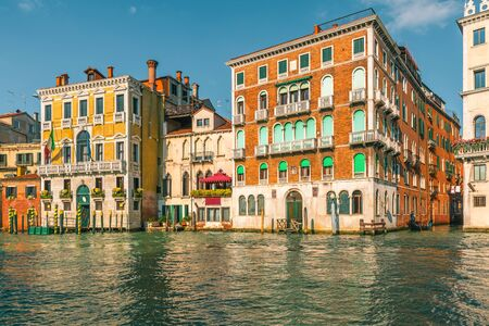 Beautiful view on colorful building facades standing along the Grand canal, Venice, Italy, Veneto Stok Fotoğraf