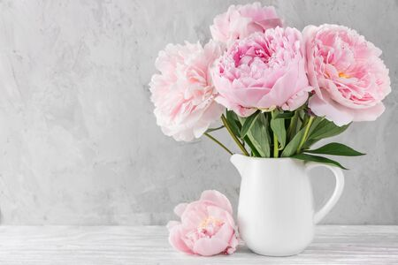 pink peony flowers bouquet on white background with copy space. still life. womens day or wedding concept. festive background