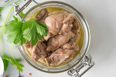 Cod liver in a jar with parsley. Natural source of omega 3 and vitamin D. top view with copy space Stok Fotoğraf