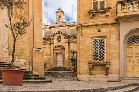 Old medieval yellow church in town Birgu. Valletta, Malta with nobody Stok Fotoğraf