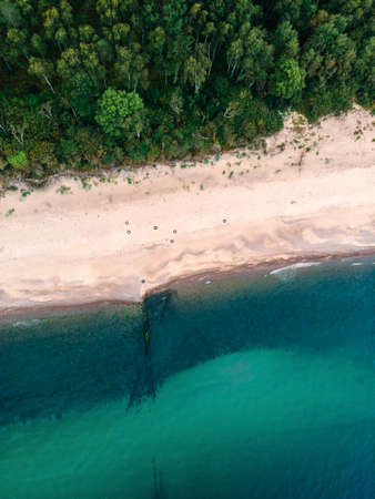 Aerial view of sandy beach, sea and forest on Baltic sea. top view. shot from drone. Landscape photography