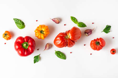 Tomato, basil, spices, pepper, garlic. Vegan diet food. Creative composition isolated on white background. Fresh vegetables cooking concept, top view Imagens
