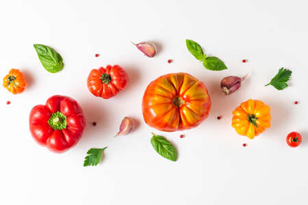 Organic vegetables composition. Tomato, basil, spices, pepper, garlic on white background. top view. flat lay. Vegan diet food cooking concept