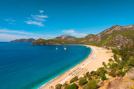 Beautiful sandy beach with yachts in Oludeniz, Blue Lagoon in Turkey. Summer holiday travel destination. Best Turkey beach Imagens