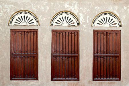 Verenigde Arabische Emiraten: Boom ramen op een oud Arabisch huis in de Verenigde Arabische Emiraten