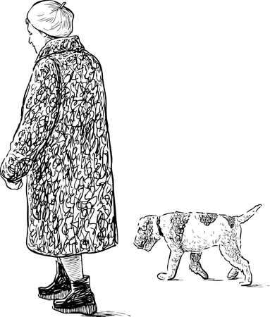 Elderly woman with her dog on a walk