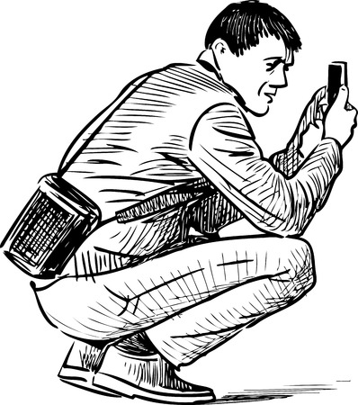 A man takes a photo on a cell phone