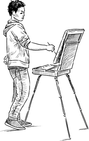 A young artist paints in open air