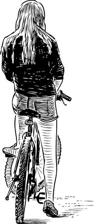 Una ragazza adolescente in bicicletta si è fermata per riposare