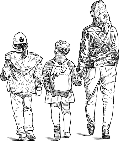 A young woman with two little girls going on a stroll
