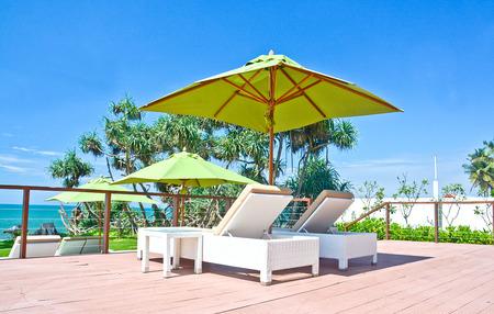 costal: Beach Umbrella And Sunbath Seats In A Tropical Beach Hotel That Located In Costal Area Negambo, Sri Lanka