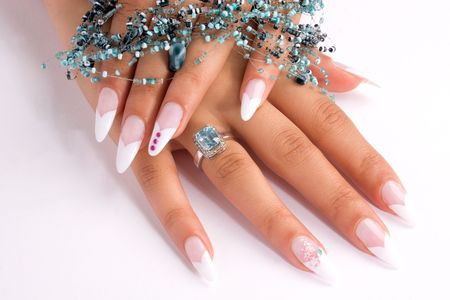cosmetic lacquer: Woman hand with beautiful colored fingernails. Cosmetic and manicure Stock Photo